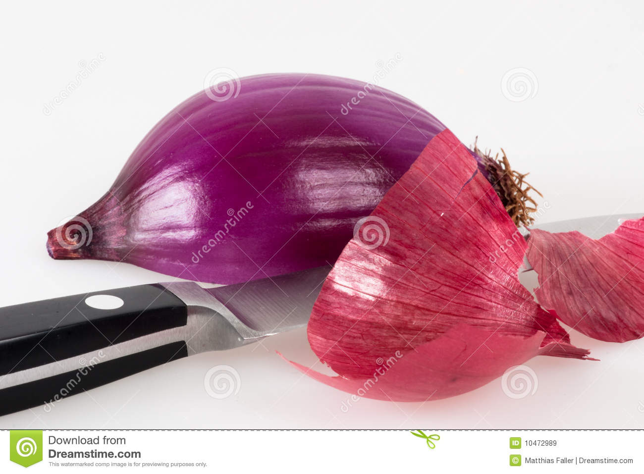 More similar stock images of ` Halved red onion with a kitchen knife `