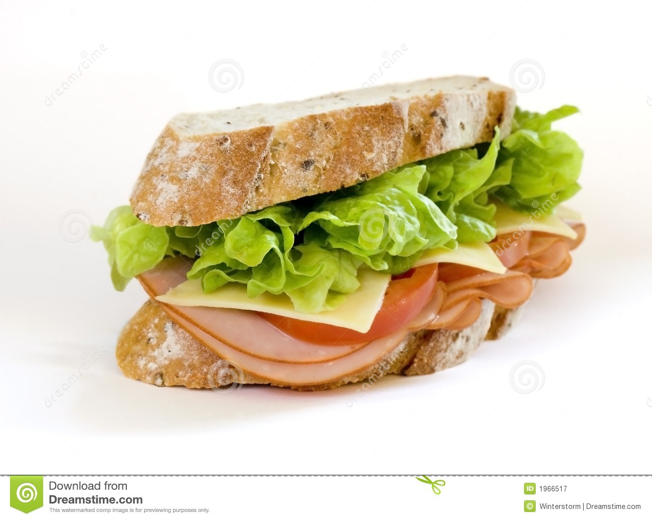 Sliced virginian ham sandwich on gourmet multi-grain bread together ...