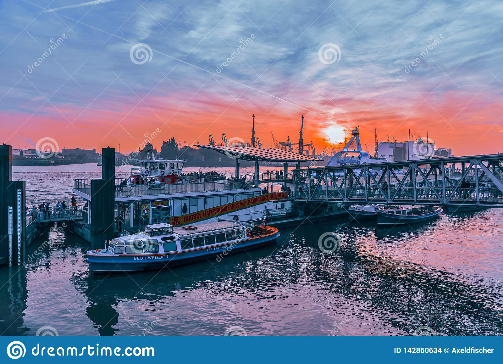 Hamburg, Germany - November 01, 2015: Tourists embark for the last harbor tour at the famous gangways of the harbor of