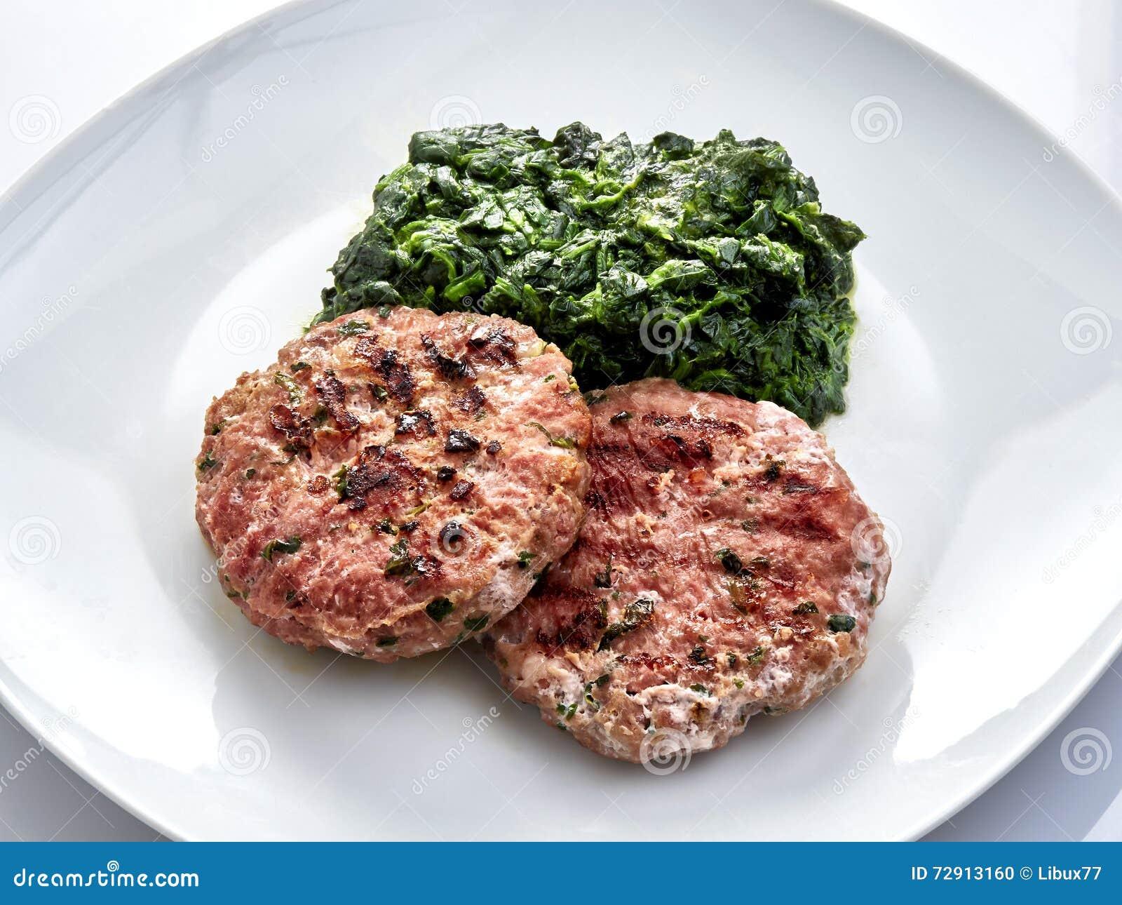 Preferenza Hamburger e spinaci fotografia stock. Immagine di erba - 72913160 KW99