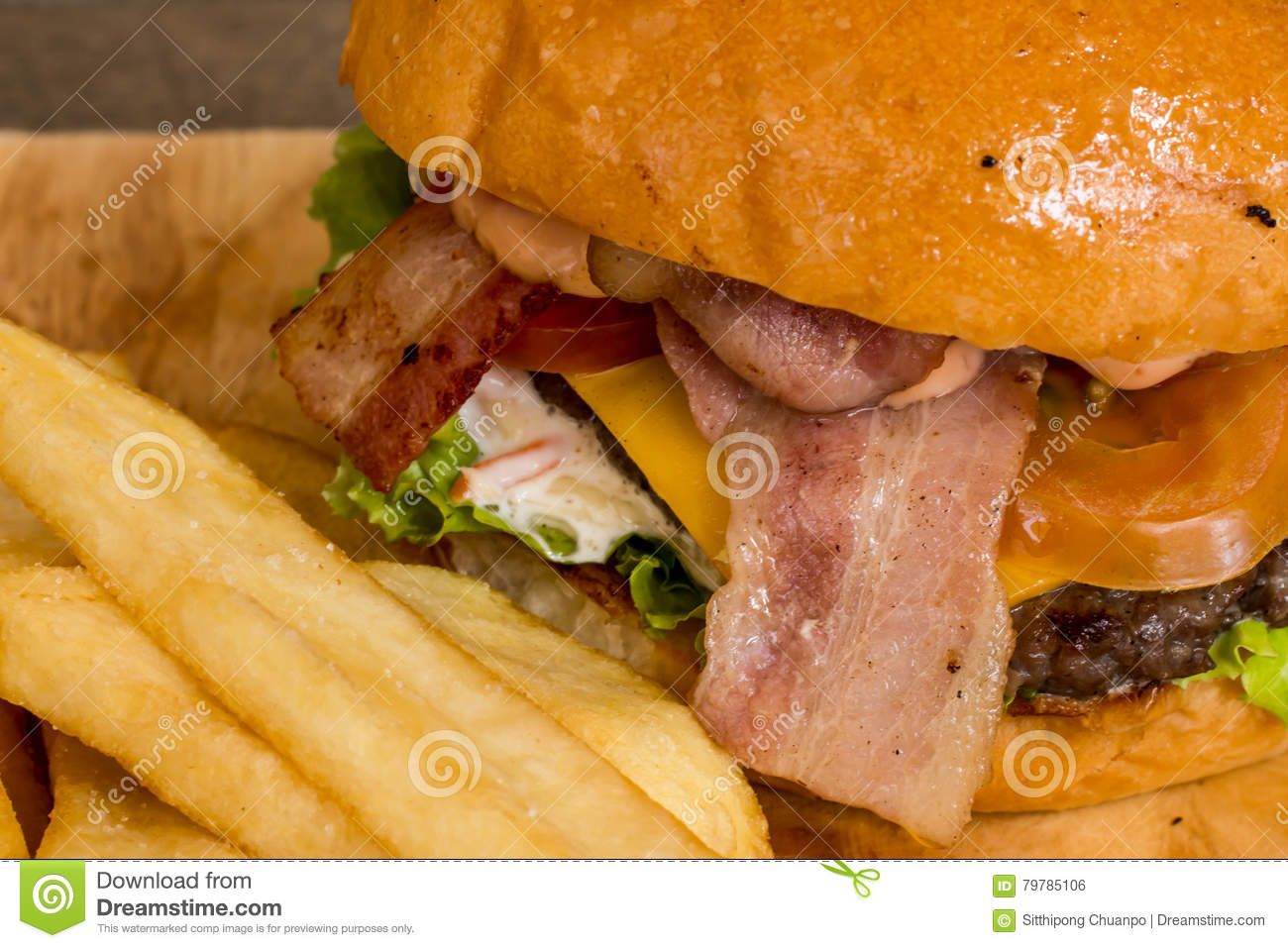 Hamburgers and French fries on the wood.