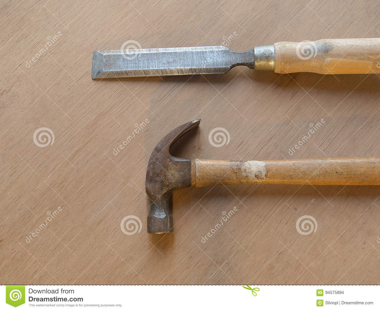 Hammer and chisel on wooden table background