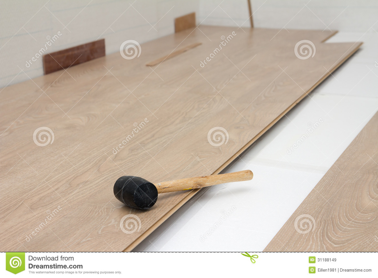 hammer on new laminate floor stock image - image of construction