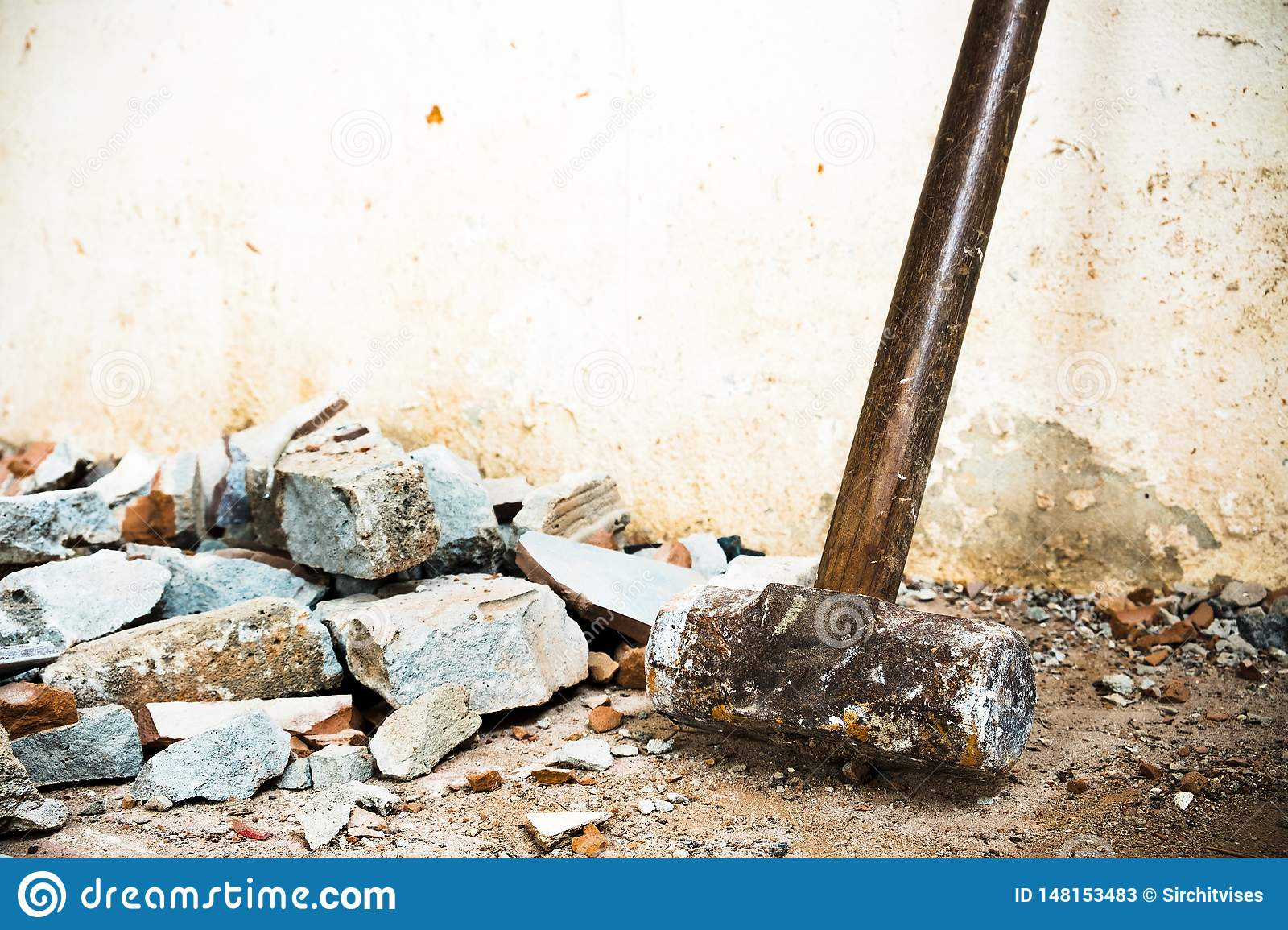 The House Of Hammer a hammer used to demolish the concrete tile floor and wall