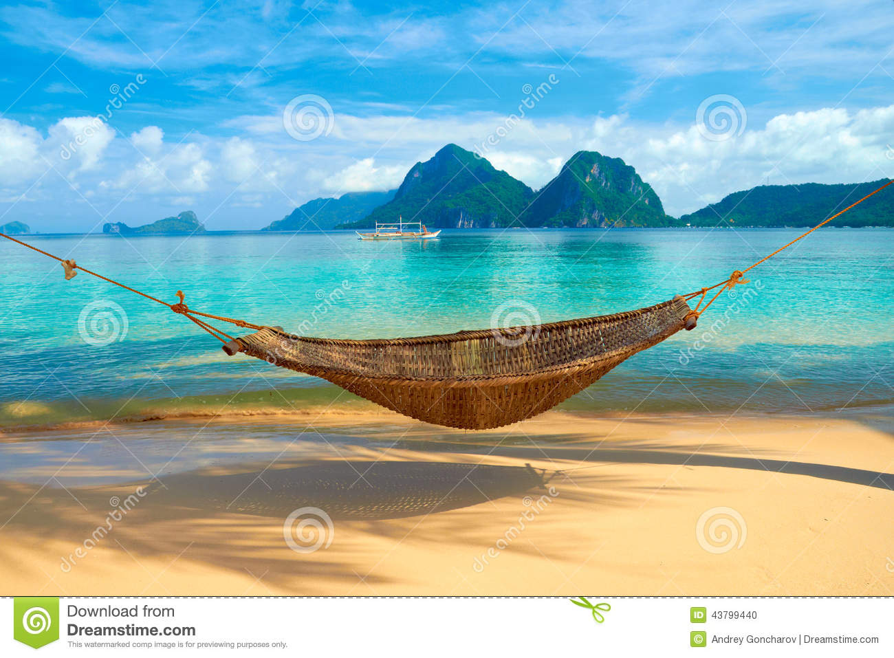 hammock at the Marimegmeg beach with the view of Bacuit Archipelago ...