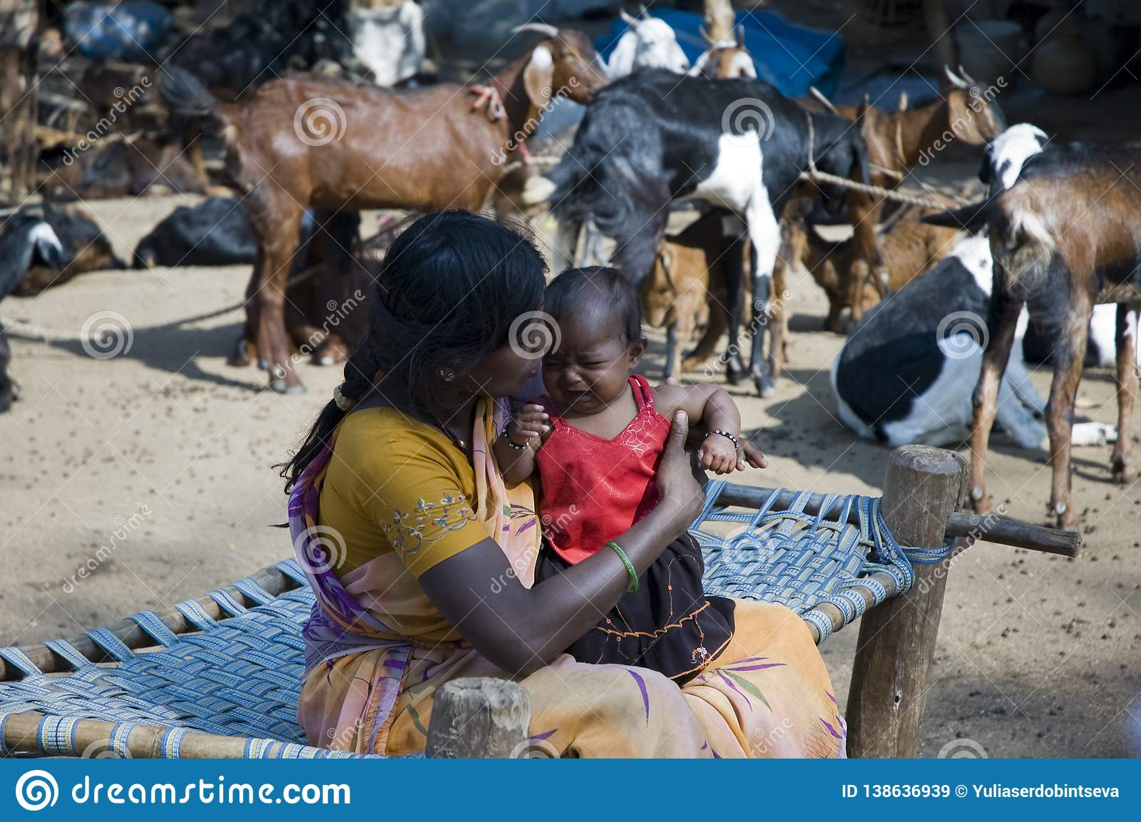 Hampi, India - February 4 2009: Candid portrait of a Mother and her Girl child