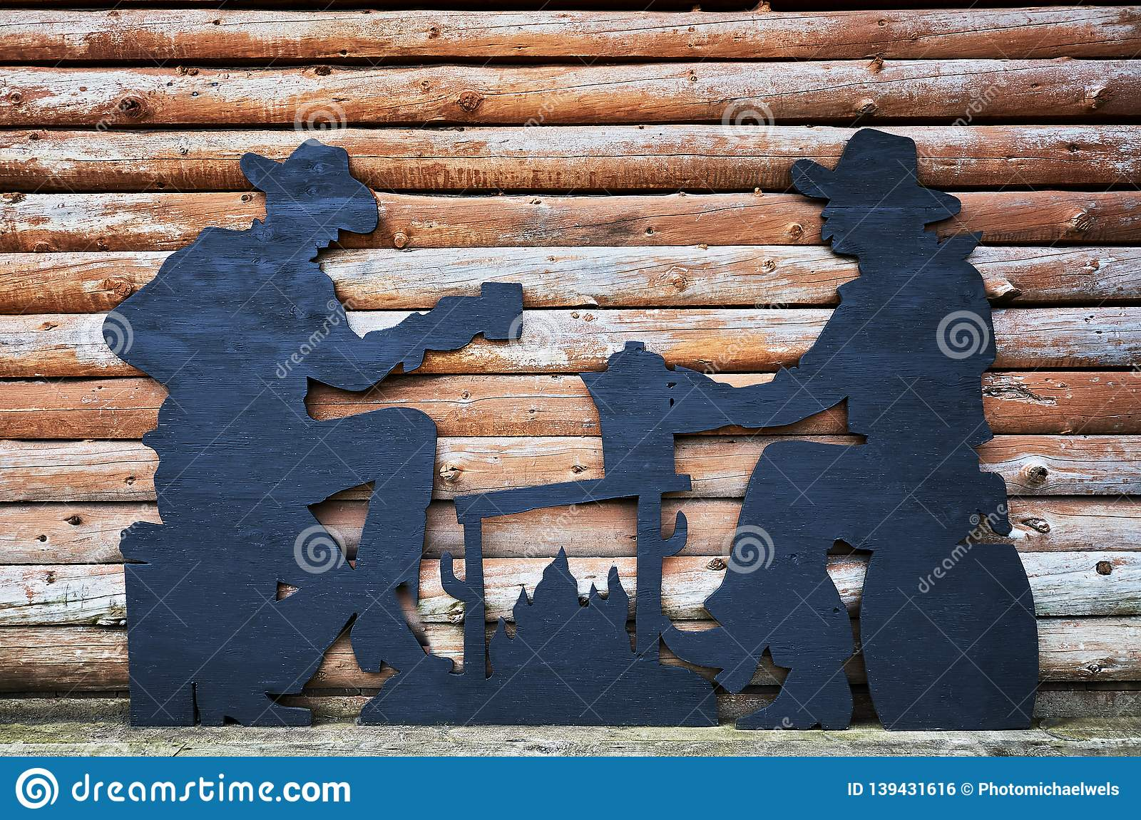 Two men drinking coffee wooden caricature