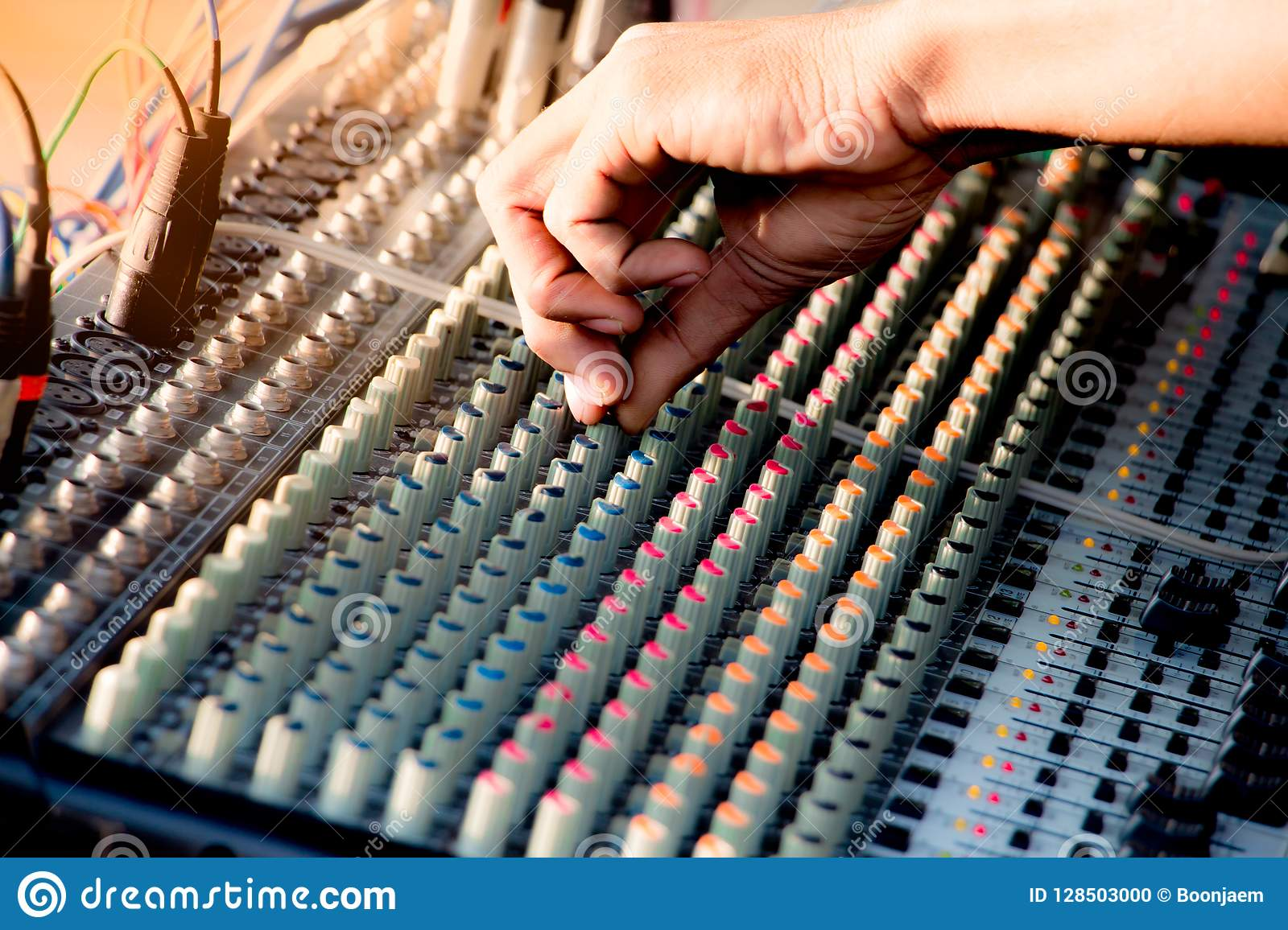 Hand adjusting audio mixer control music,music equipment for sound mixer control, electronic device.