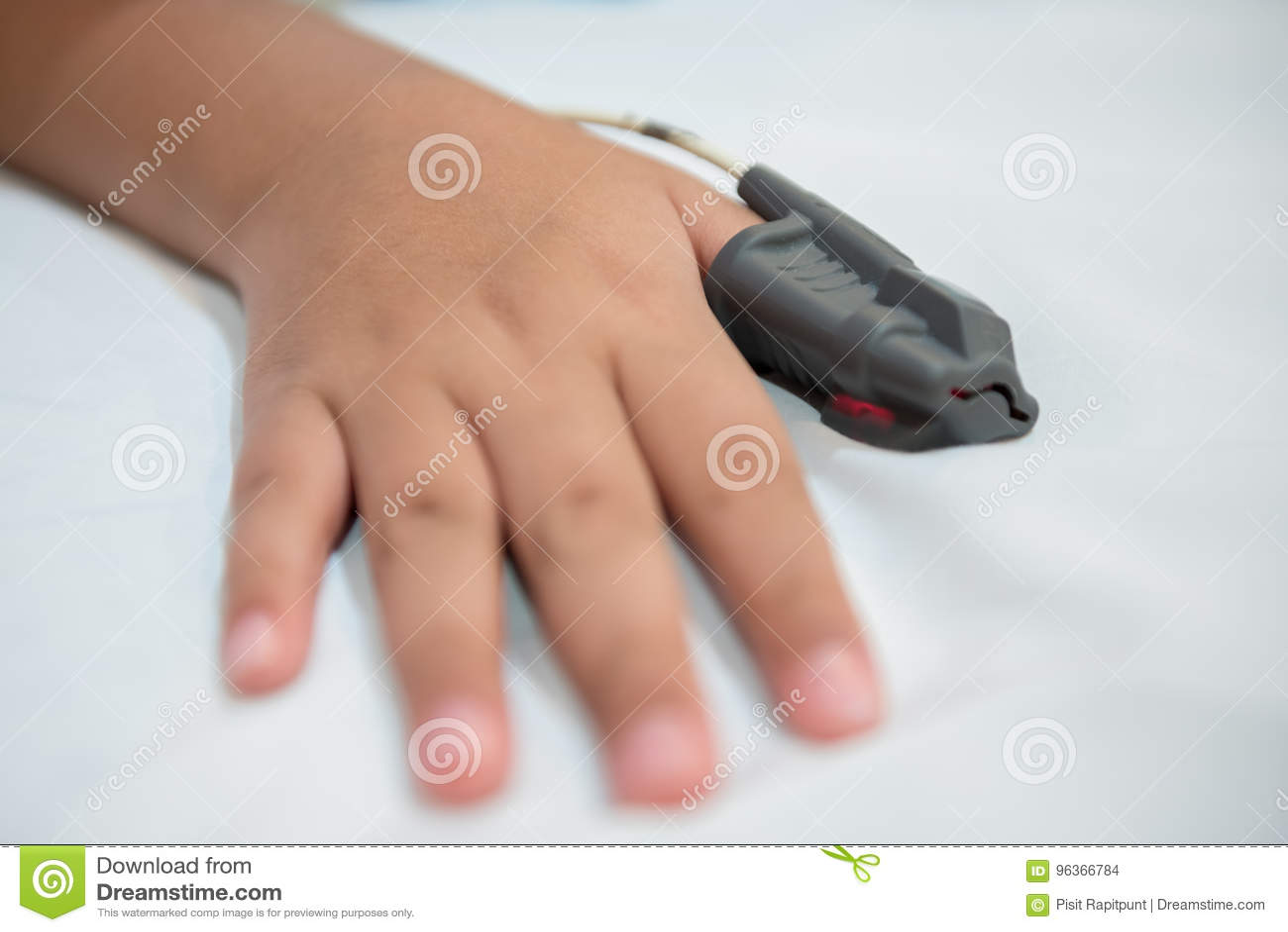 Hand of Asian boy in hospital wearing Sleep Apnea Diagnostic medical device Kit.