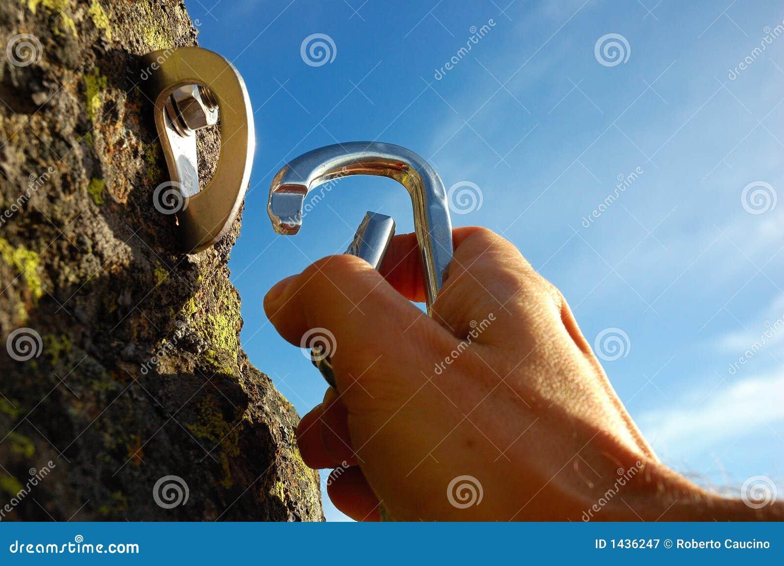 Hand attaching carabiner