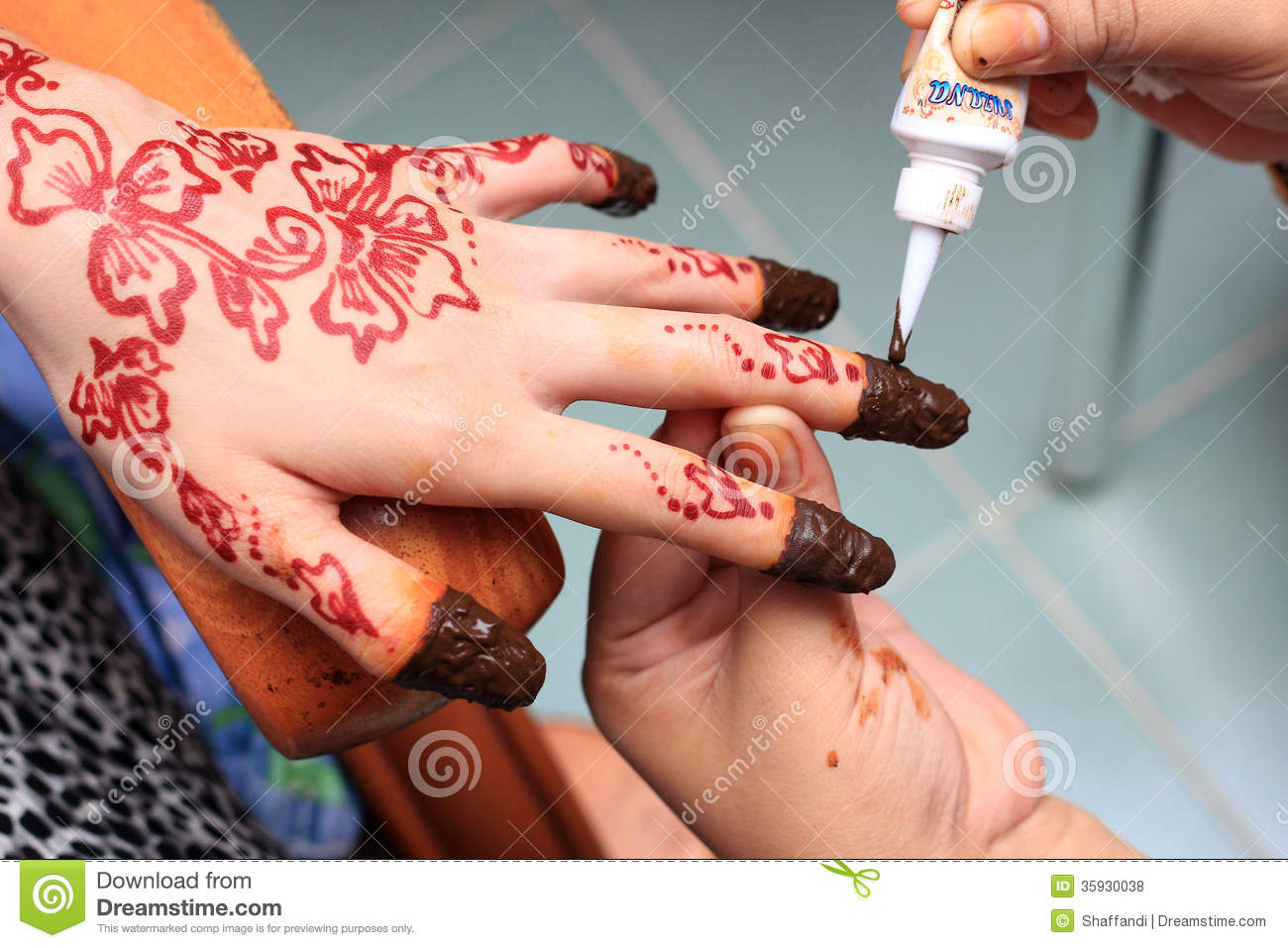 hand being decorated with henna royalty free stock photos image 35930038. Black Bedroom Furniture Sets. Home Design Ideas