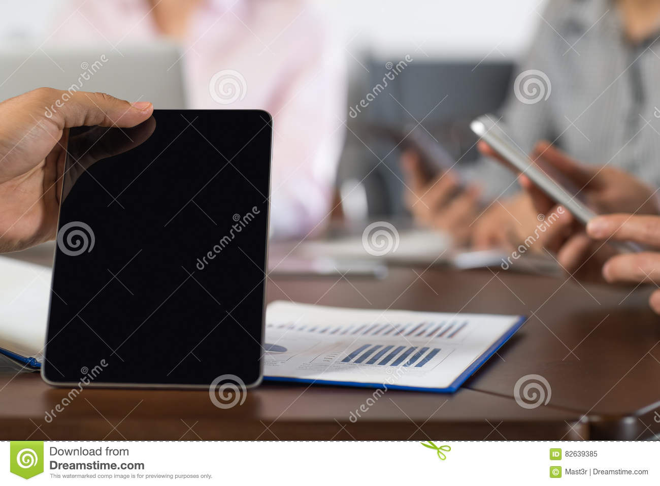 Hand Blank Black Tablet Businesspeople Group In Coworking Center Using Cell Smart Phones Team Closeup
