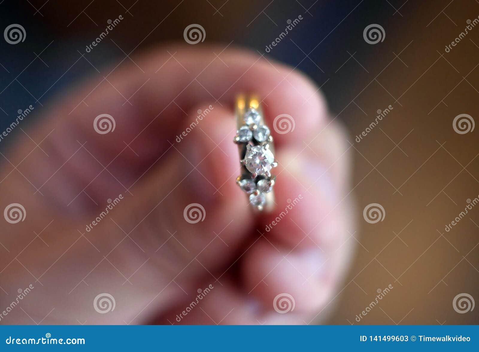 Singular Diamond Ring on Gold Band