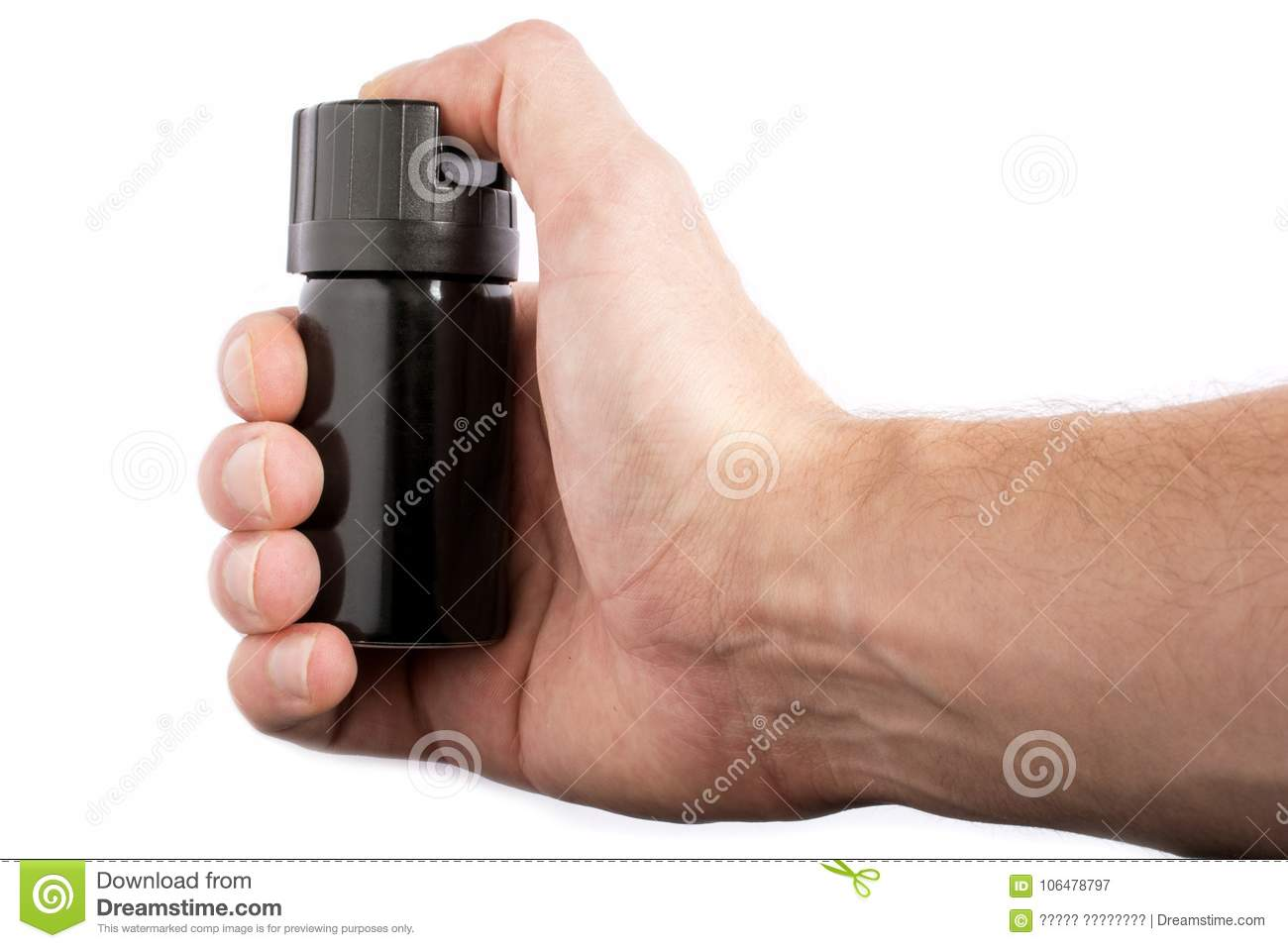 Hand with bottle of pepper spray isolated on white background