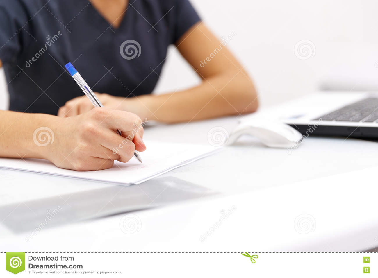 closeup of business w hand writing on paper at desk stock hand business w writing pen on paper on desktop stock images