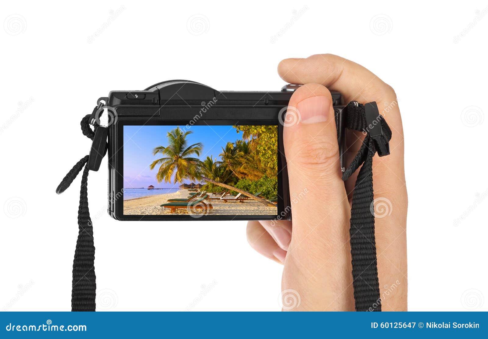 Hand with camera and Maldives beach photo (my photo)