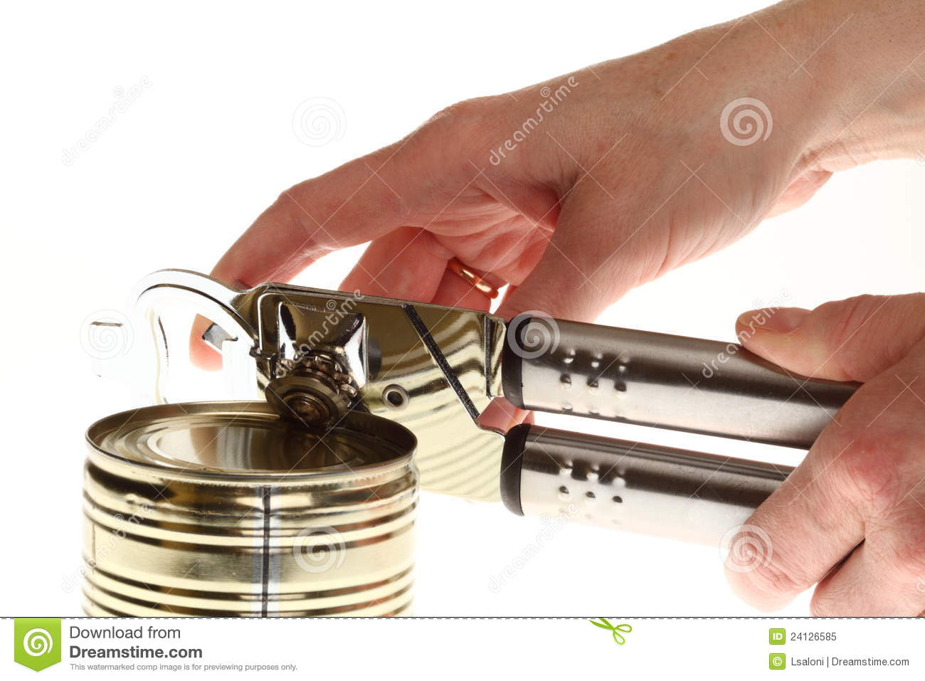 Hand Can Opener ~ Hand and can with opener stock image
