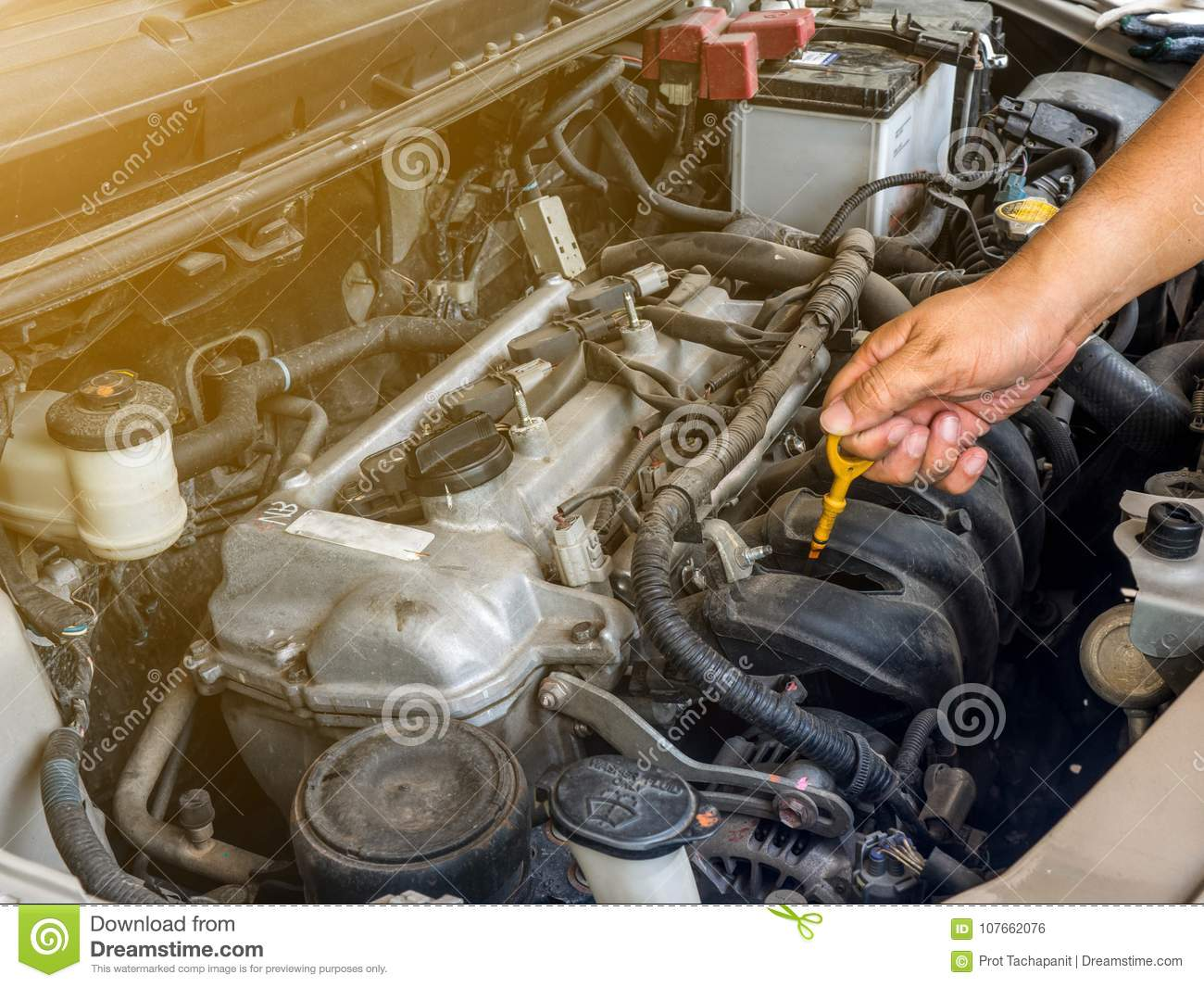 Hand Of Car Mechanic Working In Auto Repair Service  He Have