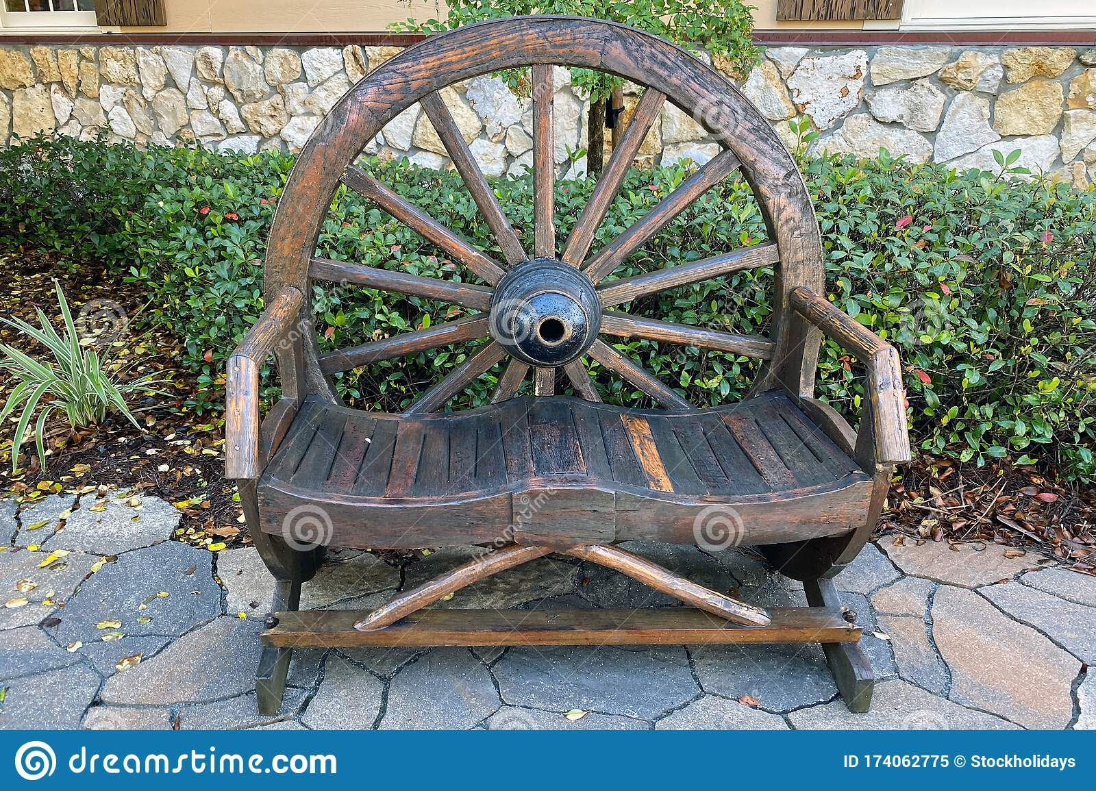 Hand Carved Wooden Wagon Wheel Garden Park Bench Stock Image Image Of Empty Culture 174062775
