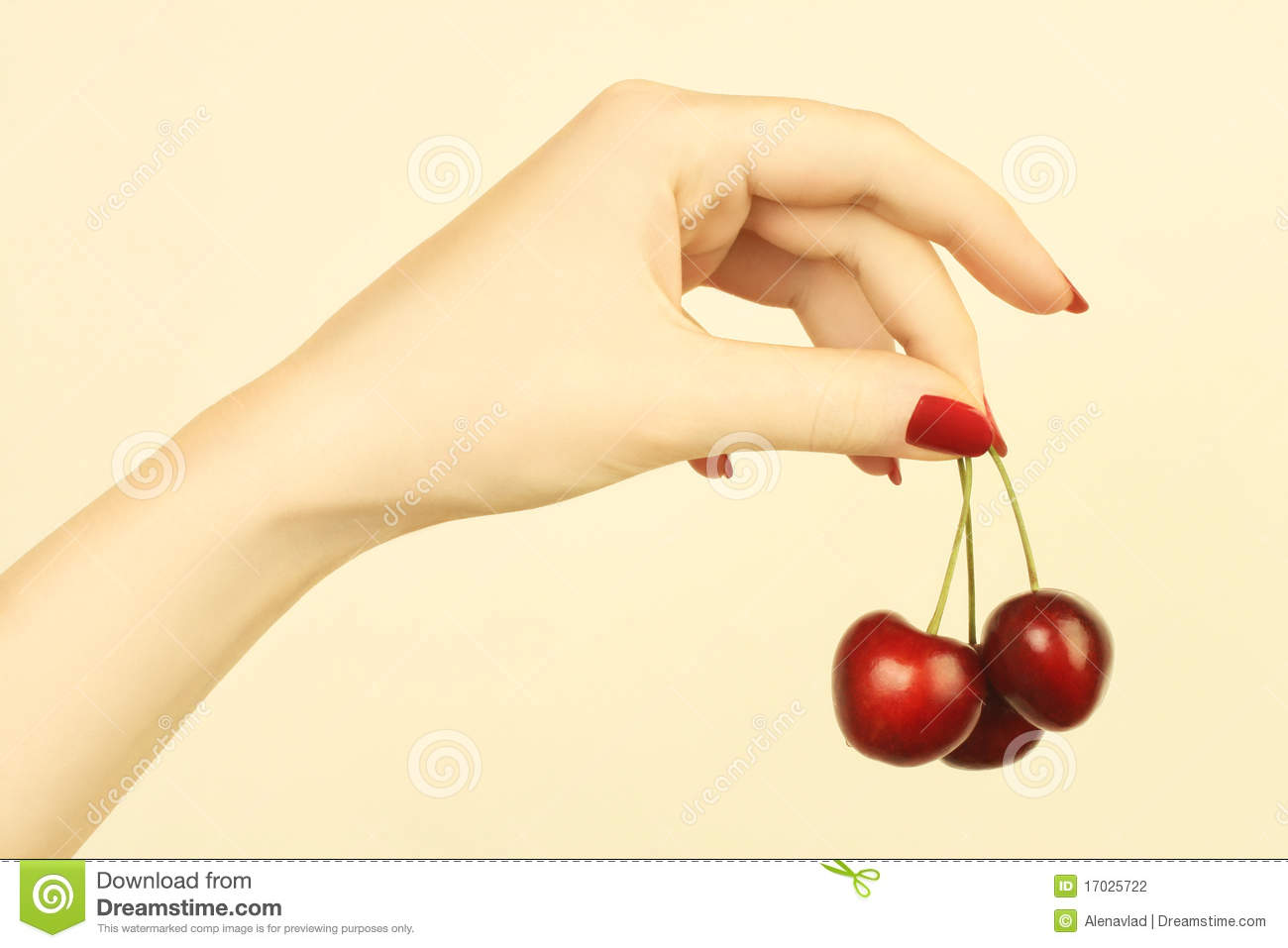 Hand with cherry