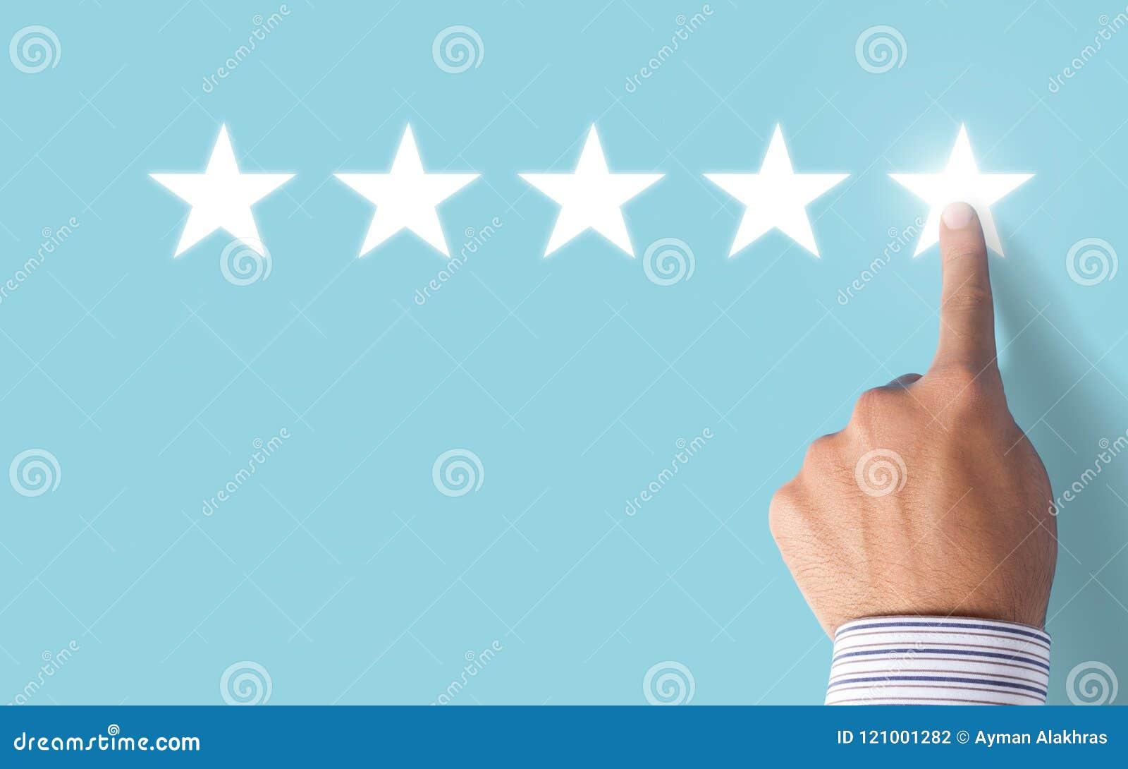 Hand choosing 5 stars rating on blue background - Positive feedback