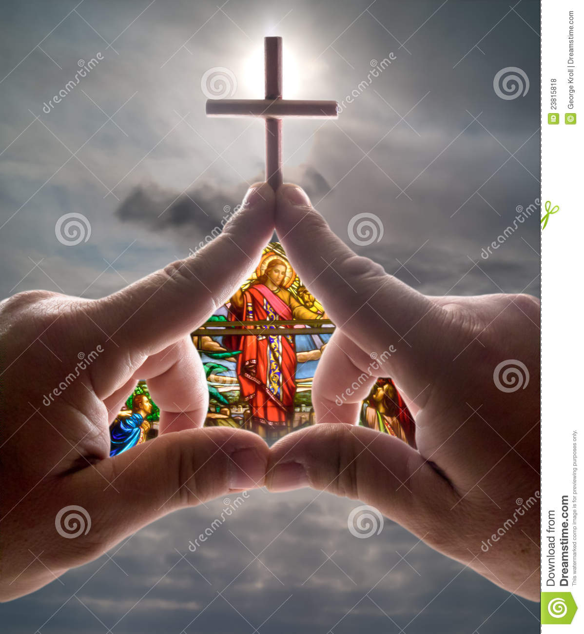 Hand church with cross stained glass against sky
