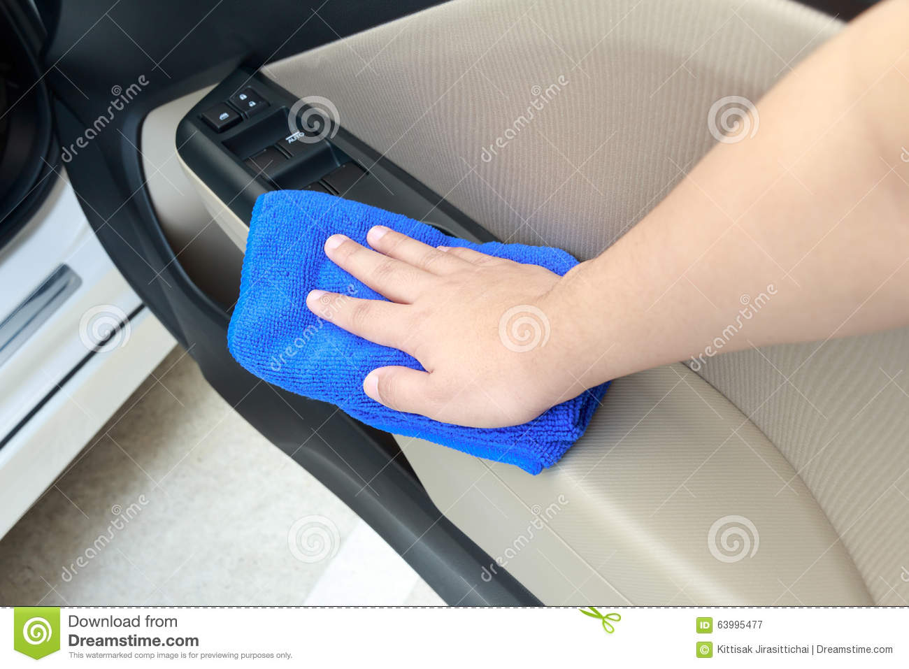 hand cleaning interior car door panel with microfiber cloth stock photo image 63995477. Black Bedroom Furniture Sets. Home Design Ideas