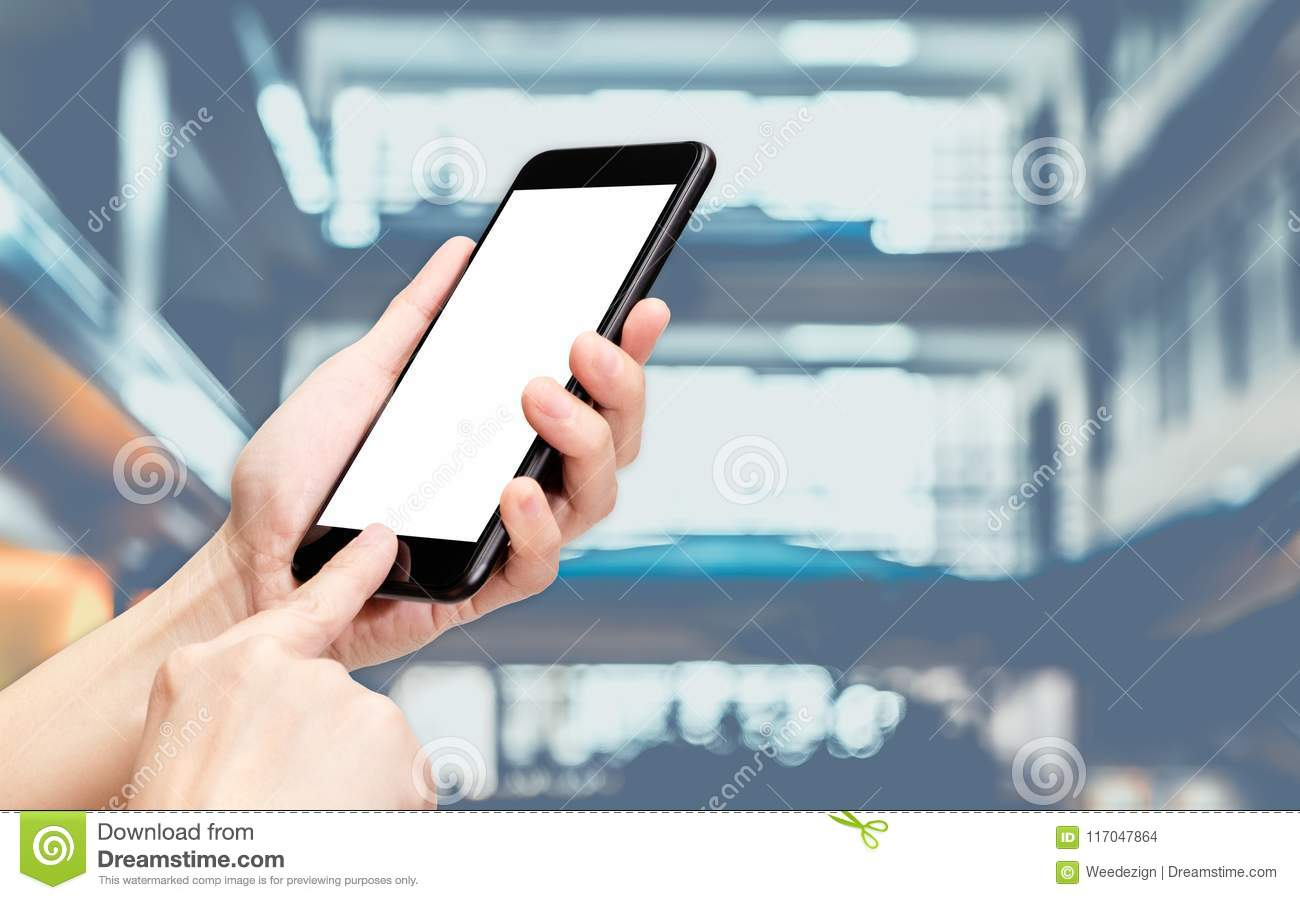 Hand Click Mobile Phone With Blur Bank Counter At Corridor