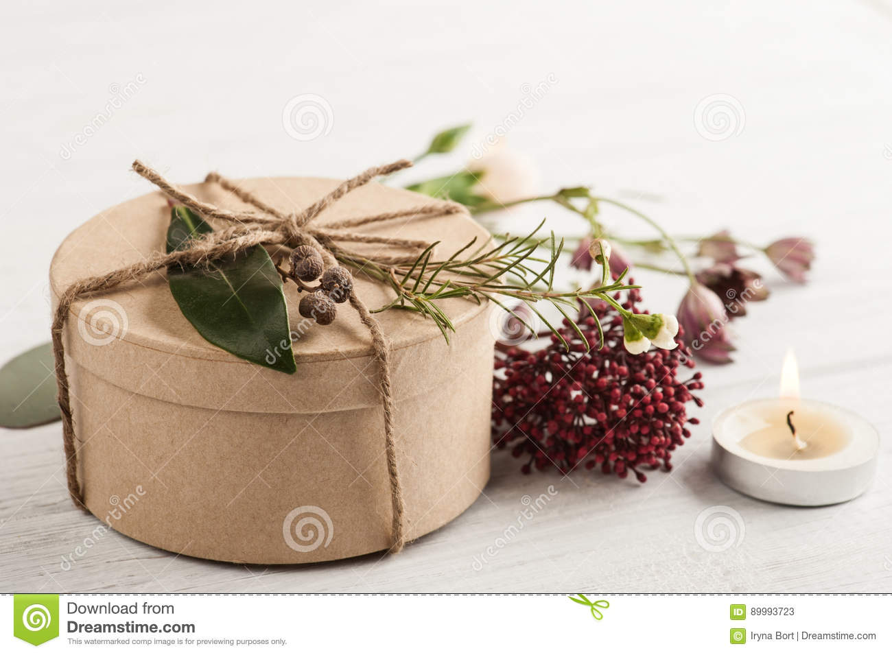 hand crafted gift and lit candle stock image image of table