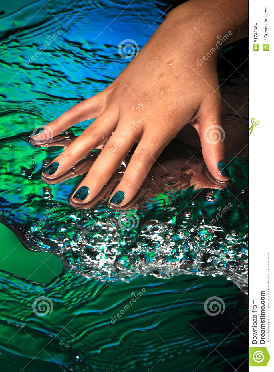 Hand With Creative Nail Design Laying On Water Background Stock