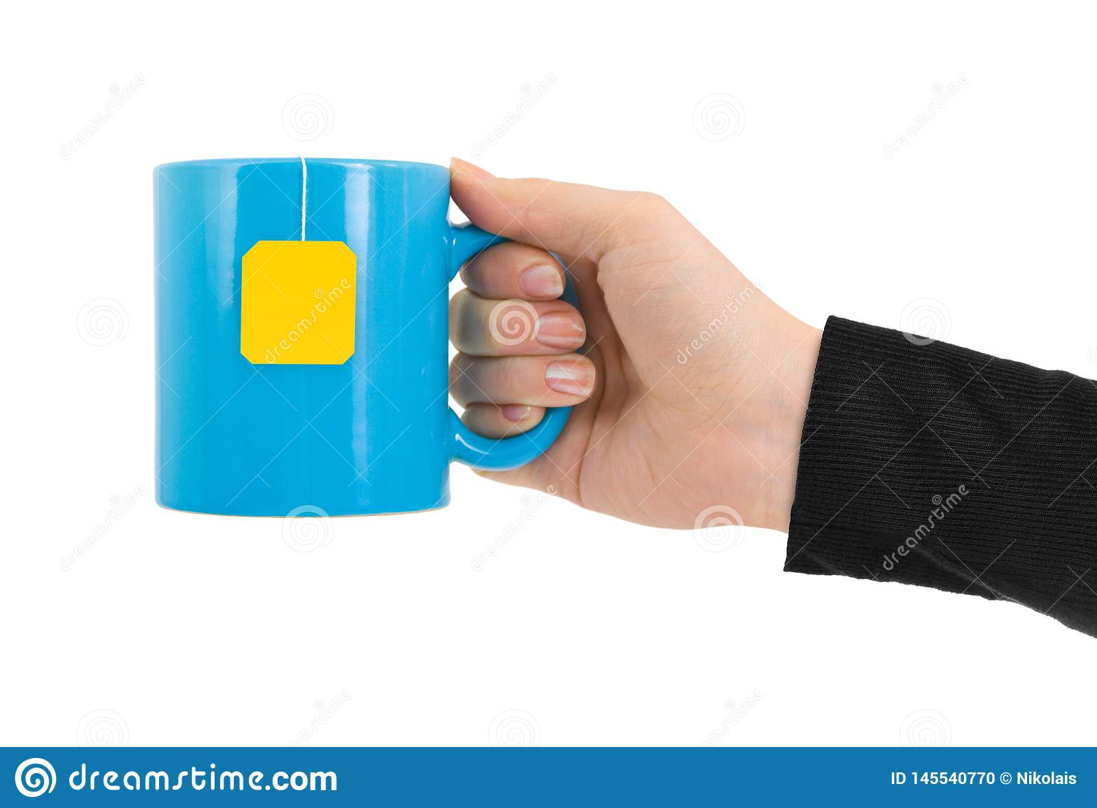 Hand and cup of tea