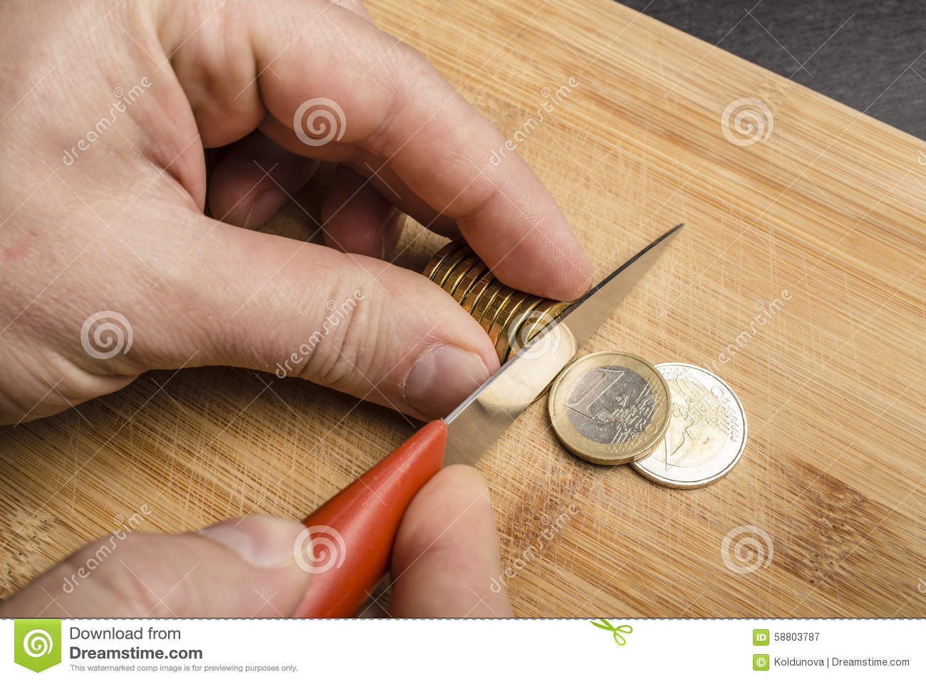 Hand Cut Euro Coins With A Knife On A Cutting Board Stock ...