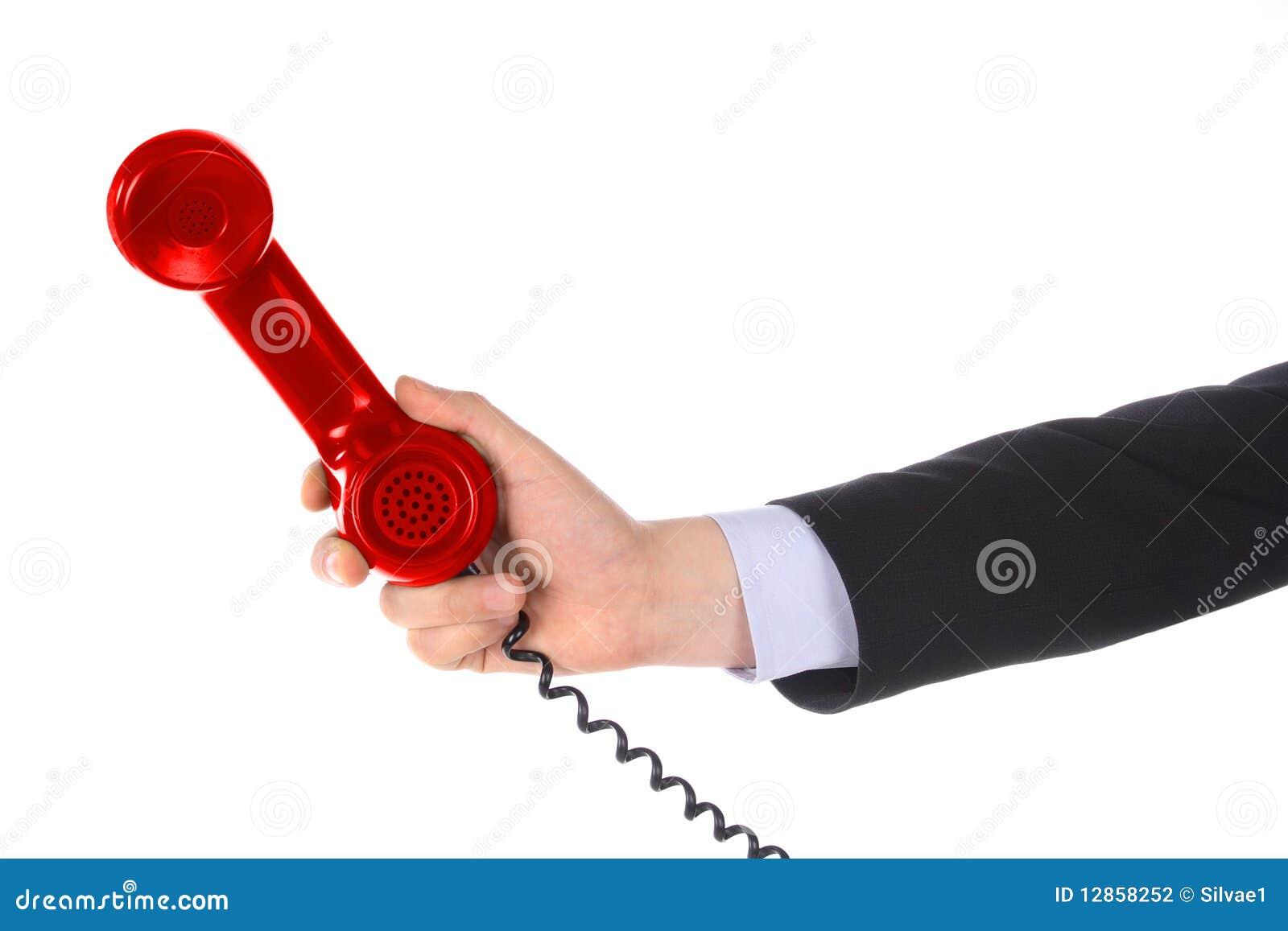 In hand de ontvanger van de telefoon