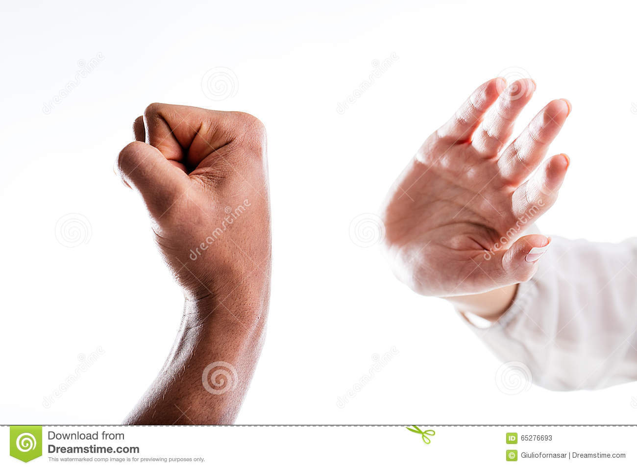 A hand defends from the punch that menaces it