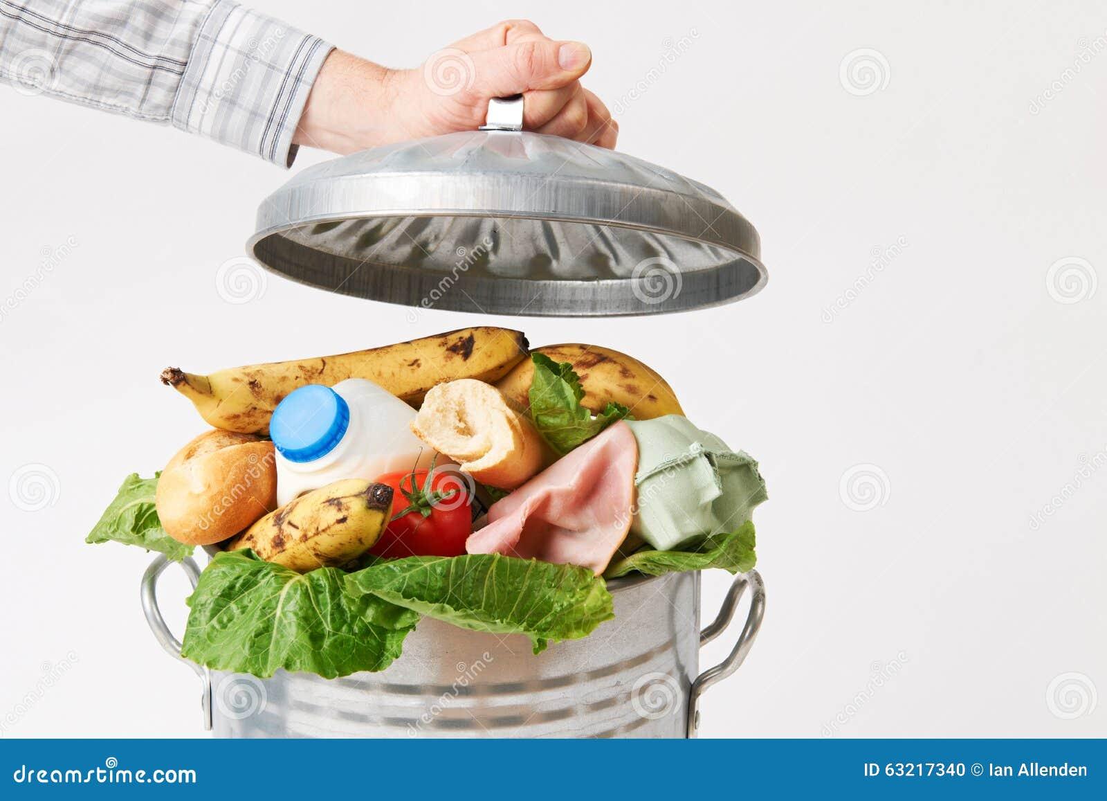 Hand die Deksel op Vuilnisbakhoogtepunt zetten van Voedselafval