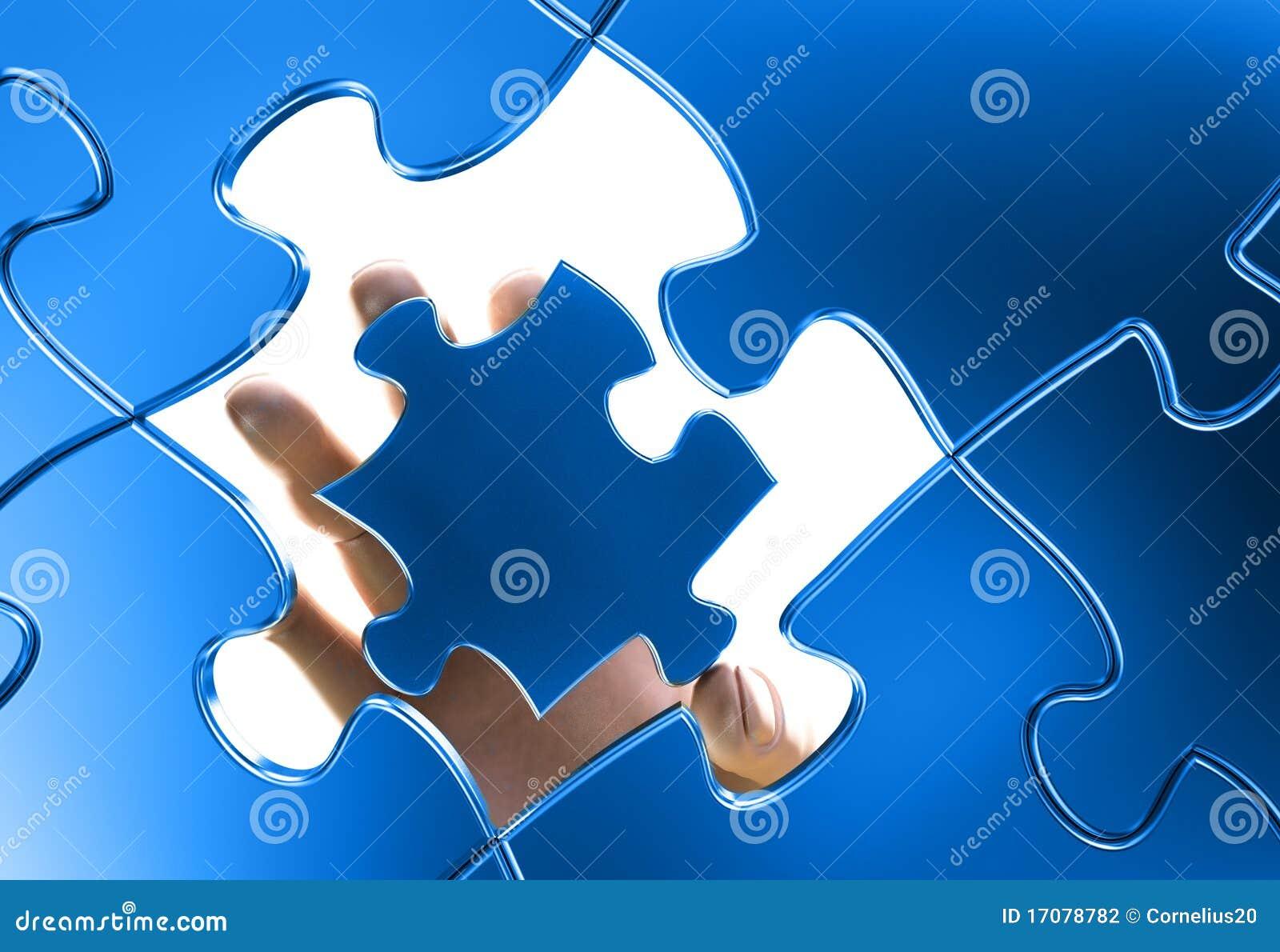 Hand, die einem Puzzlespiel sich anschließt