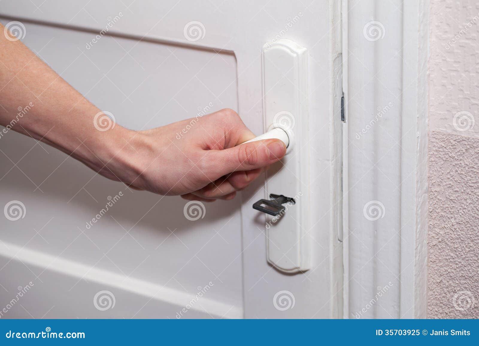 Hand and door. & Hand and door. stock image. Image of keyhole home lock - 35703925