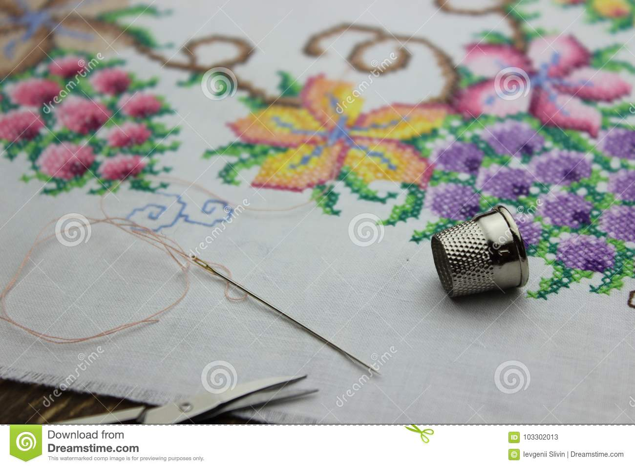 Hand embroidery with needle and scissors
