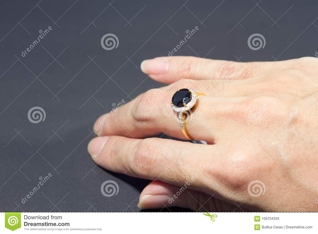 Hand Female Wears A Black Diamond Ring With Middle Finger A Diam