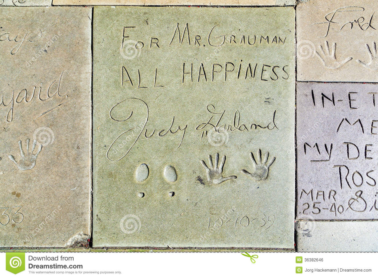hand  and footprints of judy garland in front of the tcl