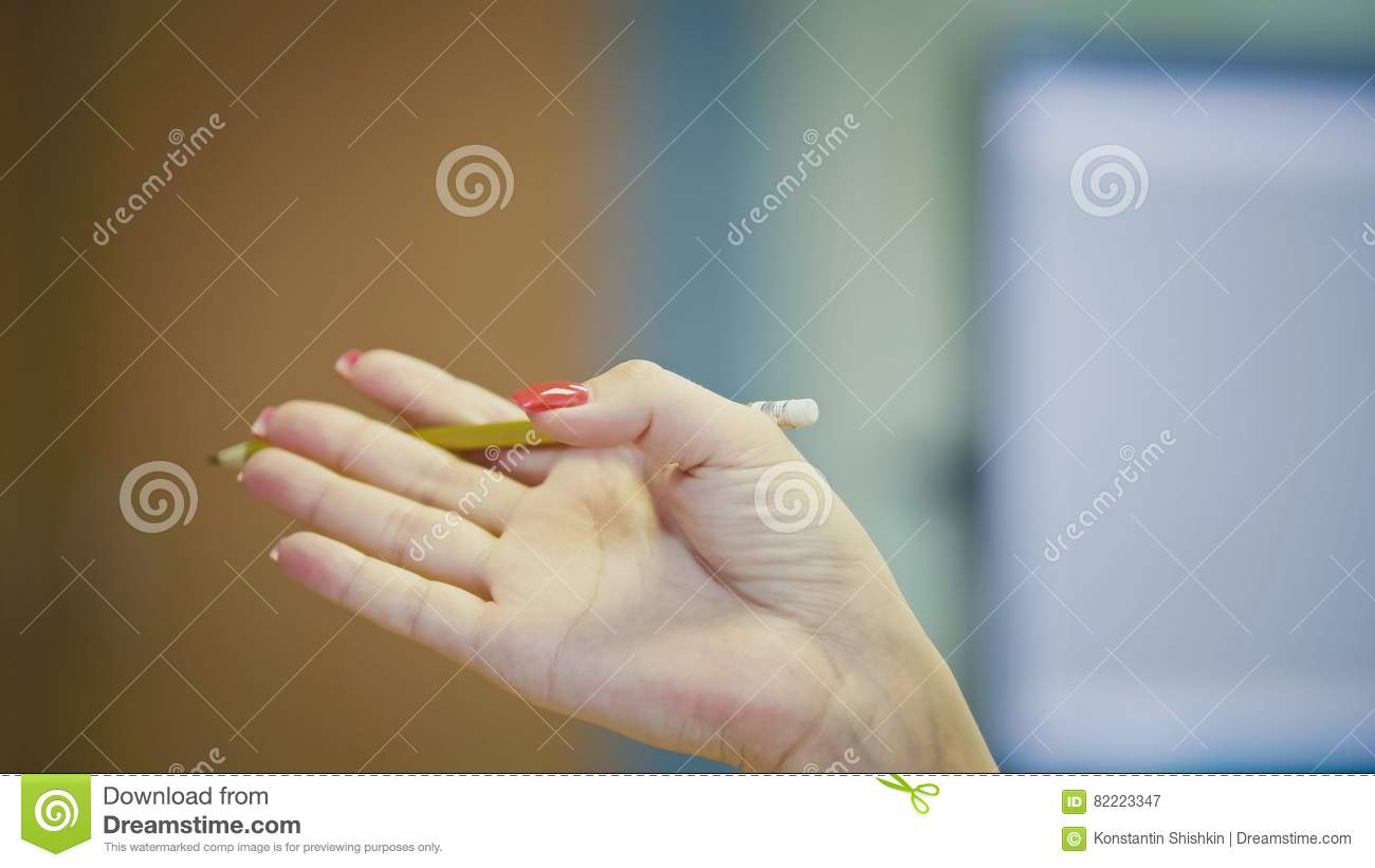 Hand gestures of Woman Office Manager when talking on the phone - manicure with bright red nails, close up