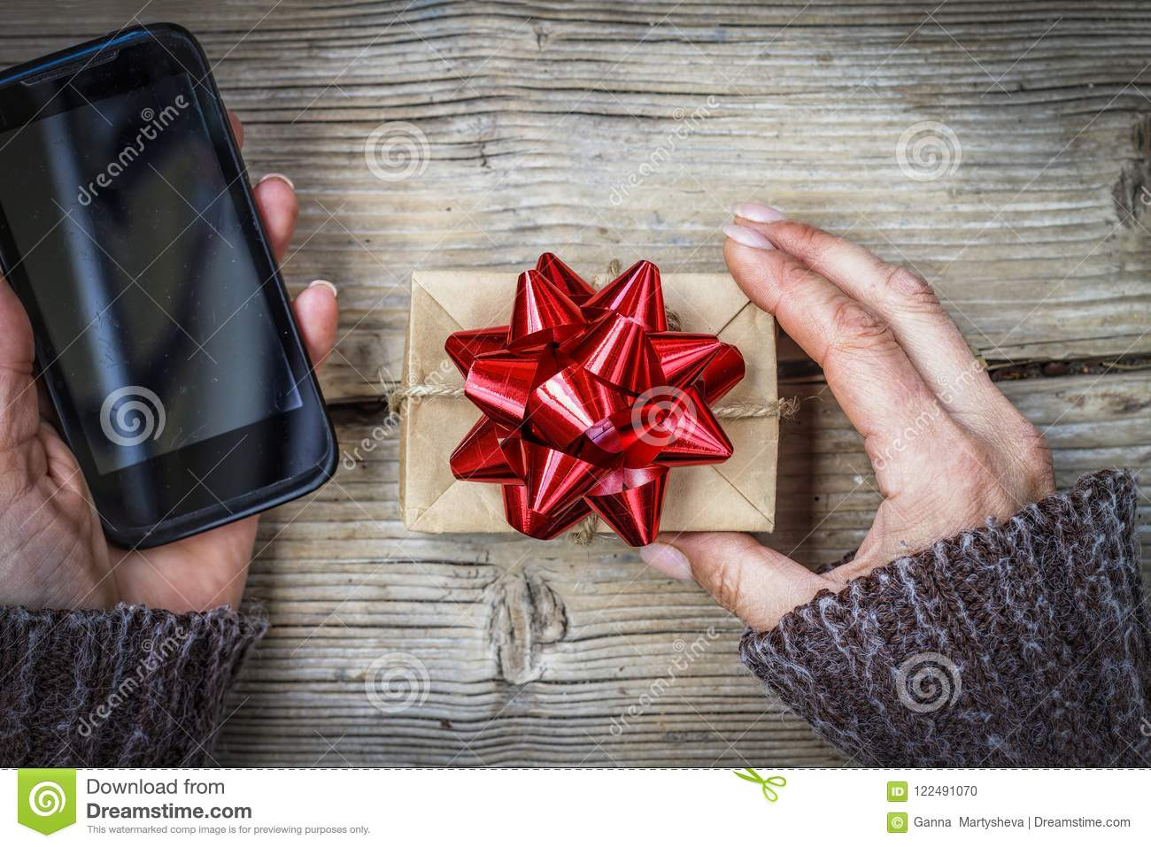 Gift And Smartphone In Female Hands Christmas Birthday Mothers Day Valentines Oncept Of A Order Via The Internet