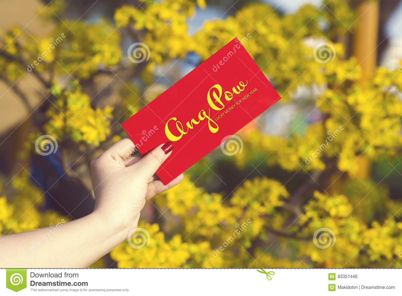 Hand give money in red envelopes - ang pow or red packet to some