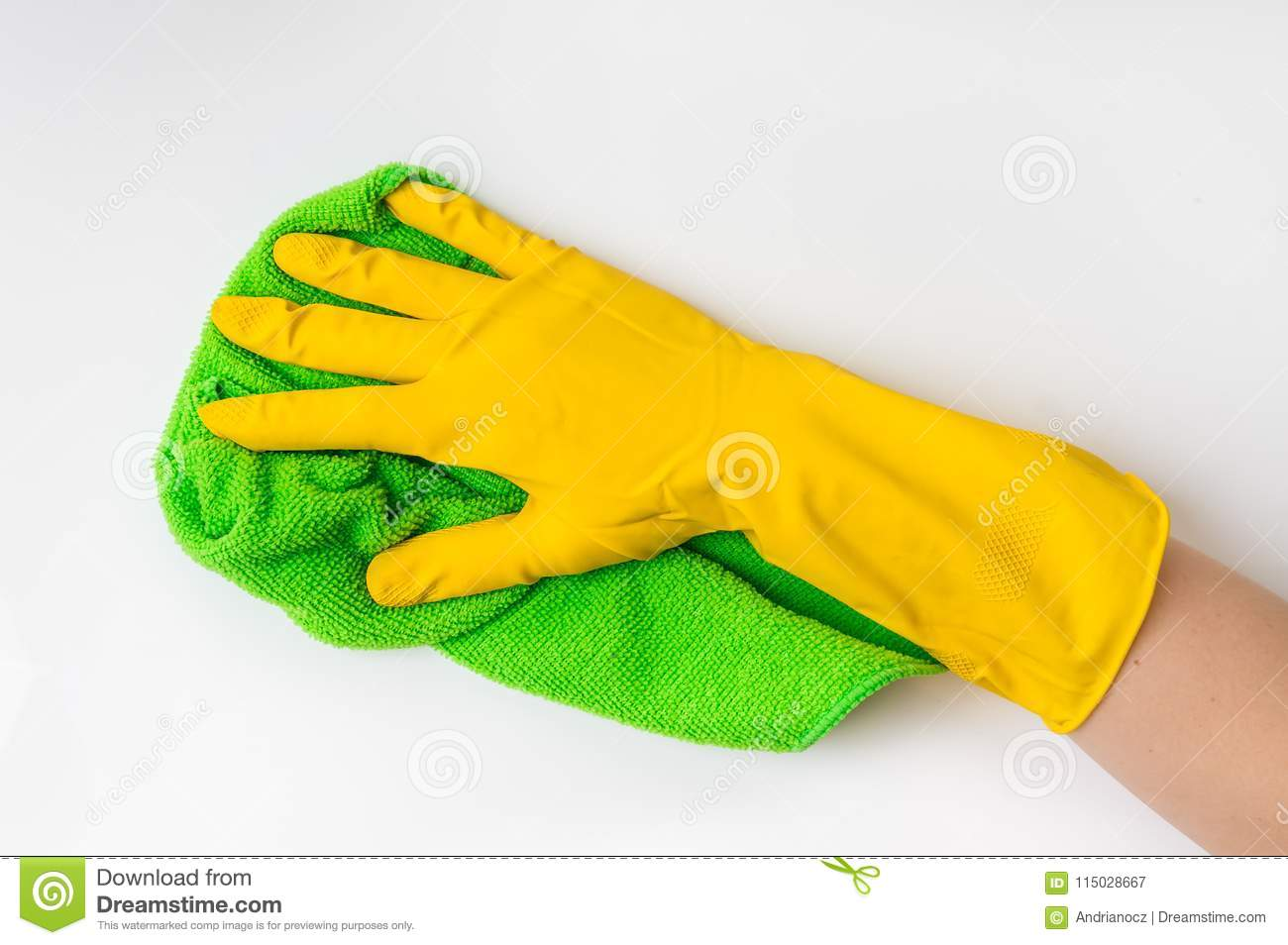 156e73fe83b6c Hand in glove with green rag is wiping white door in kitchen - housework  and housekeeping concept