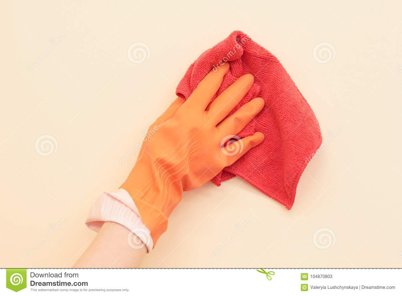 A hand in a glove washes the wall.