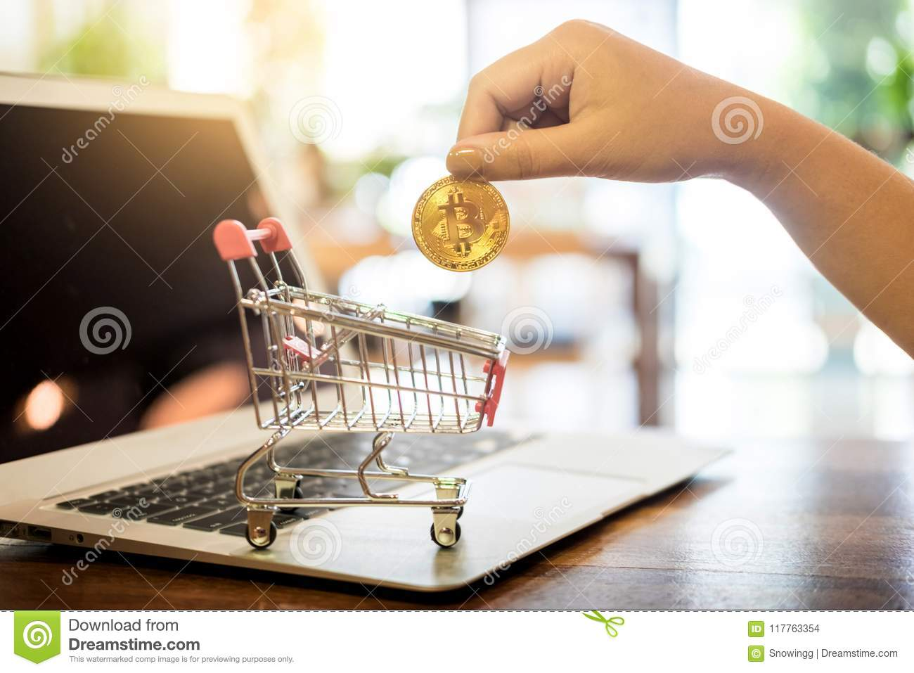 hand with golden metal Bitcoin crypto currency investment- symbolic block chain financial internet and technology.