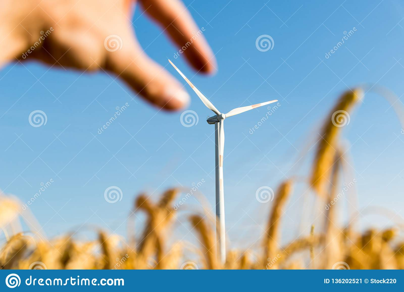 Hand grabbing the blade of a wind turbine