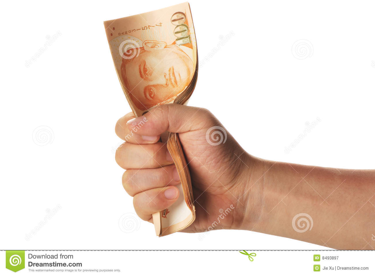 Hand grasping a stack of singapore dollars