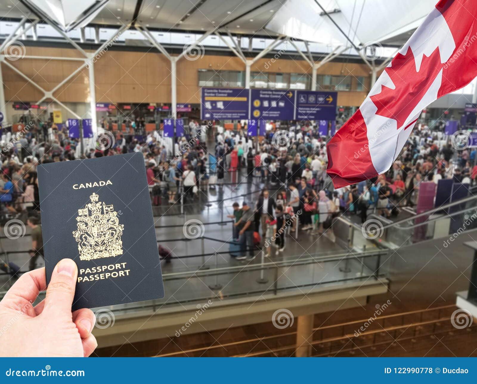 Hand handing Canadian passport
