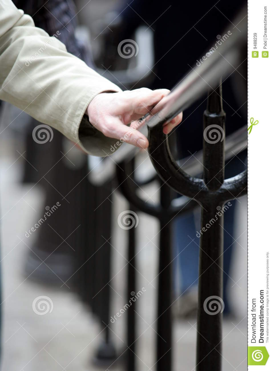 Hand on a handrail